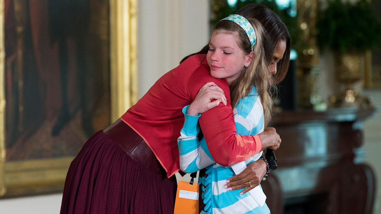 First lady Michelle Obama hugs Charlotte Bell