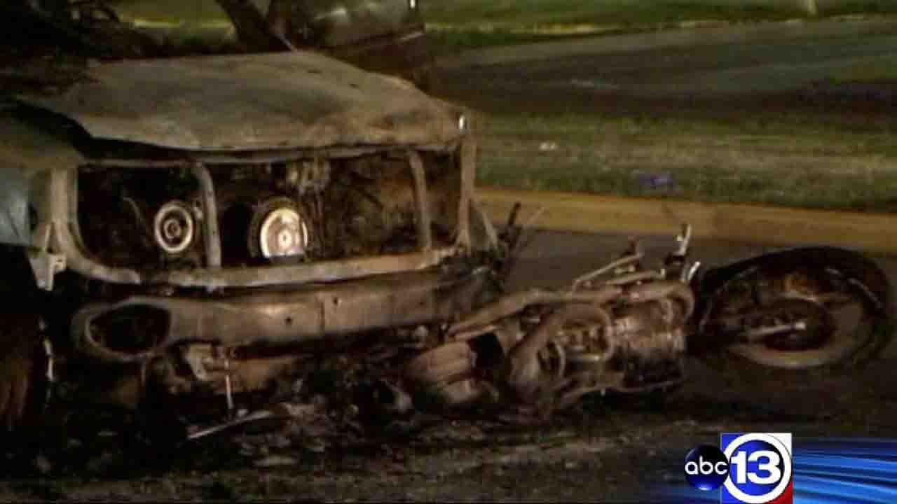 Officials say the SUV involved inthe crash was stolen. The driver dragged the bikers body for several yards until it burst into flames