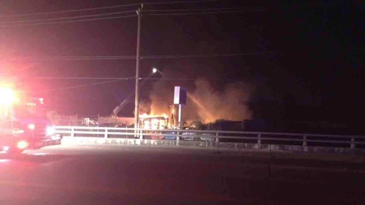 A fire burns at an auto parts store in north Harris County
