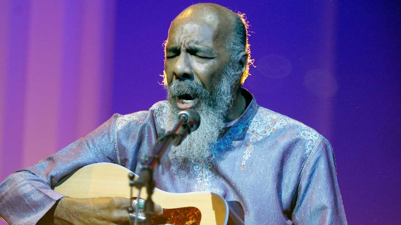 In this May 1, 2008 file photo, Richie Havens plays at the opening night ceremony during the 61st International film festival in Cannes, southern France. Havens, who sang and strummed for a sea of people at Woodstock, has died at 72. His family says in a statement that Havens died Monday, April 22, 2013, of a heart attack. (AP Photo/Jeff Christensen, file)
