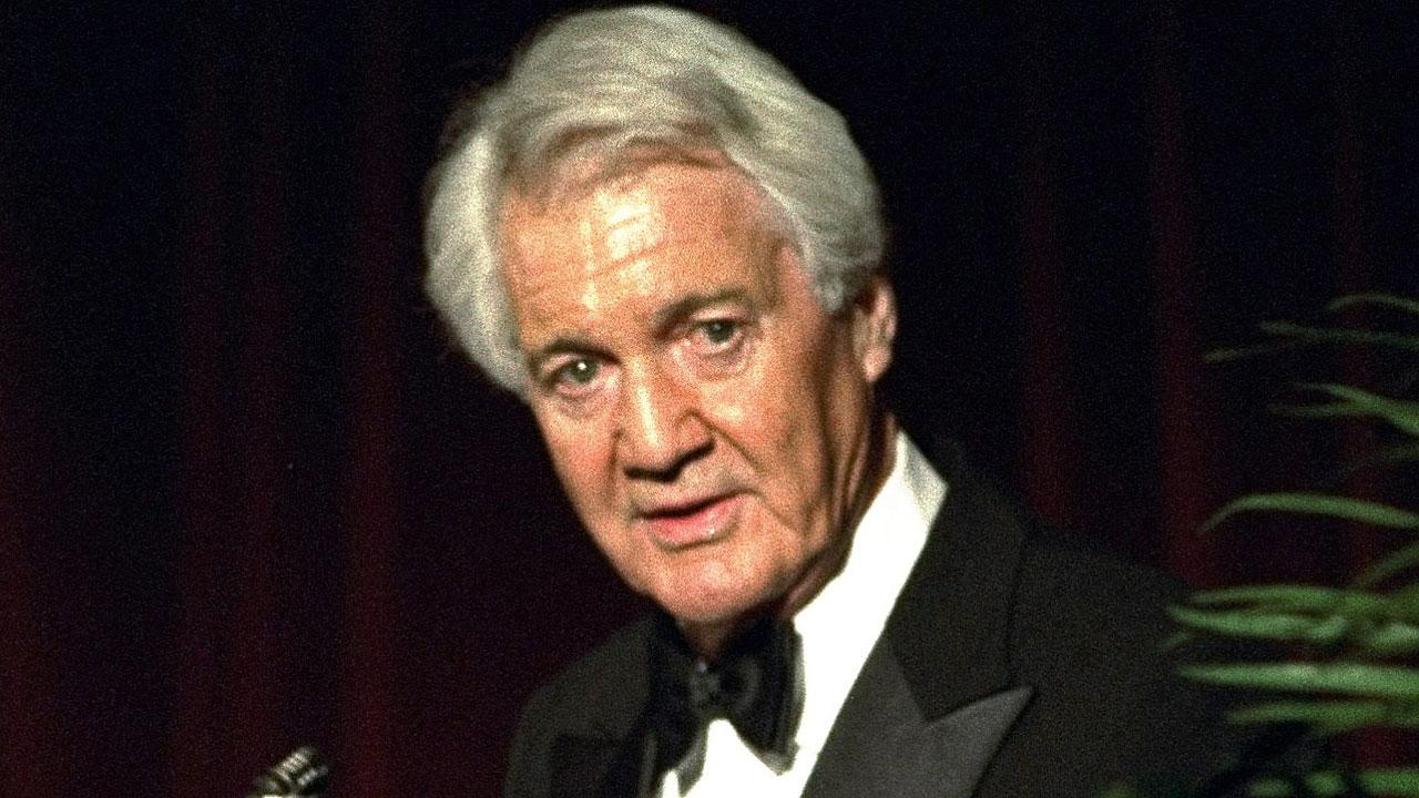 Pat Summerall, completing his 34th and final season with CBS, receives an award for lifetime achievement at the 1994 Sports Emmy Awards in New York on Tuesday, April 19, 1994. (AP Photo/Rob Clark)