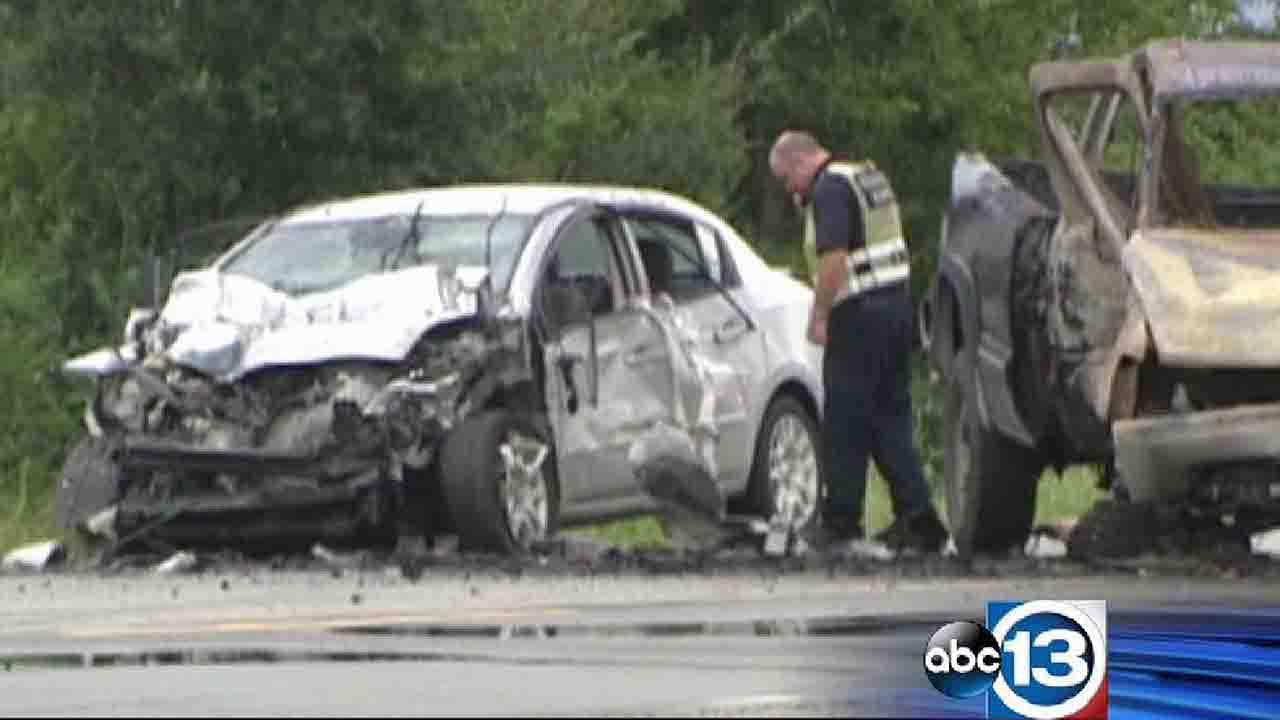An investigator looks at the wreckage from an alleged road rage crash in the Crosby area