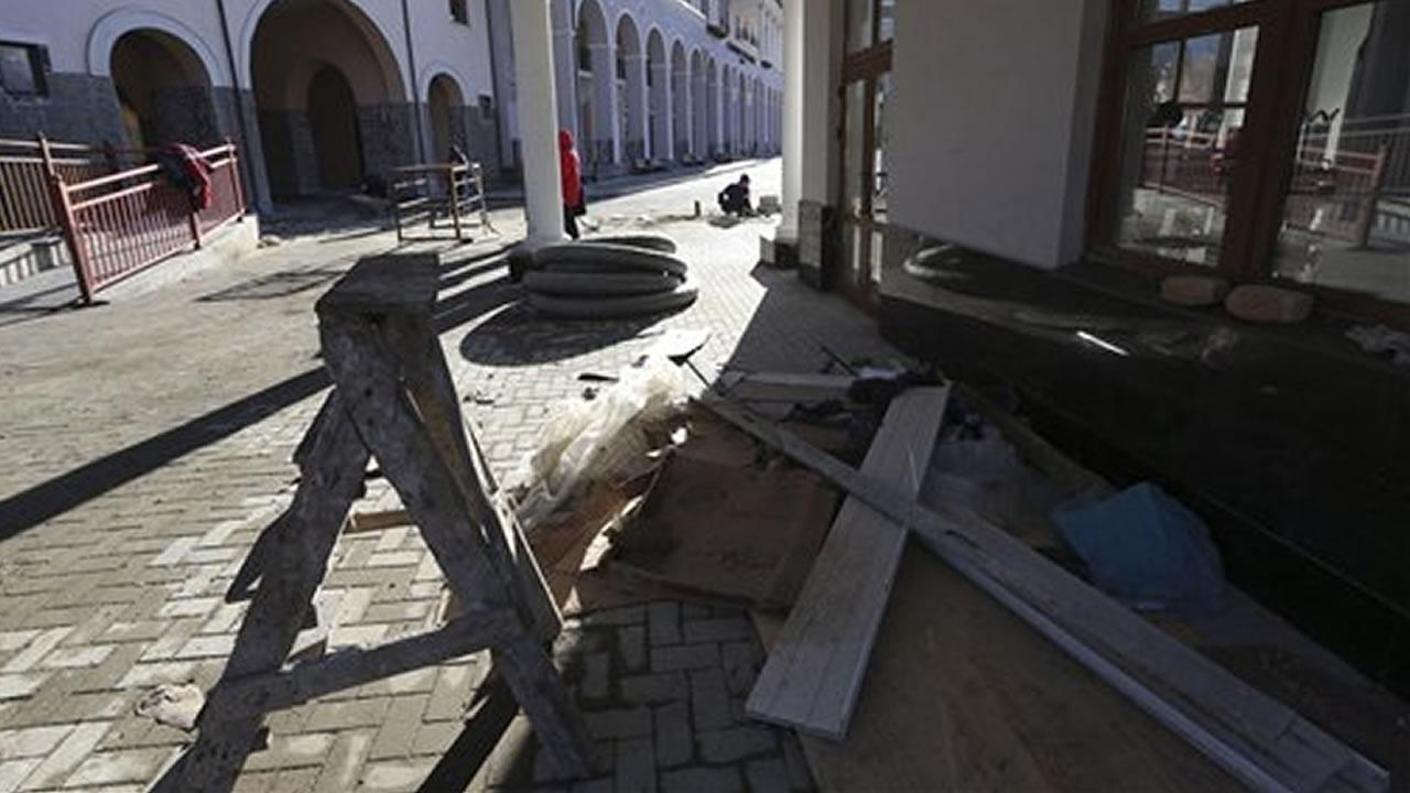 Building debris is left outside the Gorki Plaza East hotel in Krasnaya Polyana, Russia Sunday, Feb. 2, 2014.
