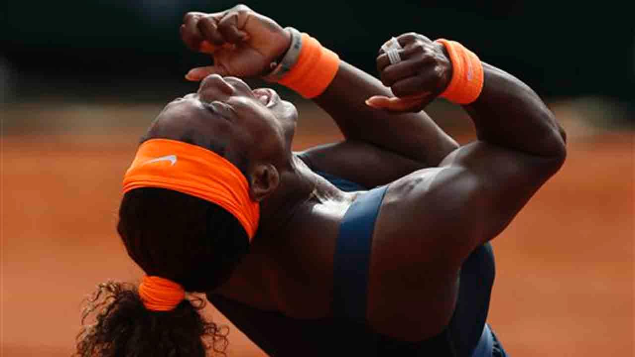 Serena Williams of the U.S. celebrates winning against Russias Maria Sharapova in two sets 6-4, 6-4, in the womens final of the French Open tennis tournament, at Roland Garros stadium in Paris, Saturday June 8, 2013. (AP Photo/Petr David Josek)