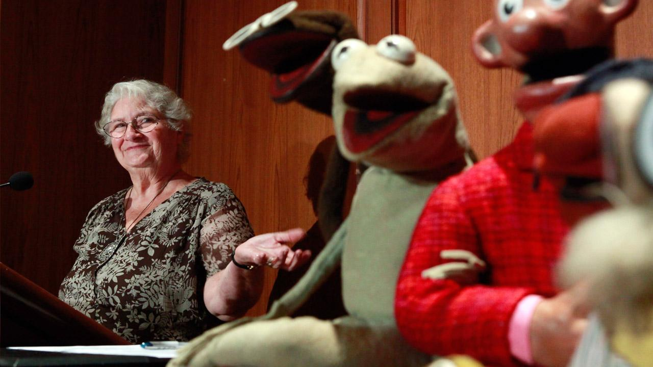 FILE- in this Wed., Aug. 25, 2010 photo, Jane Henson, left, donates some of Jim Hensons early puppets, including the original Kermit, to the Smithsonian Institution, during a ceremony at the National Museum of American History, in Washington.