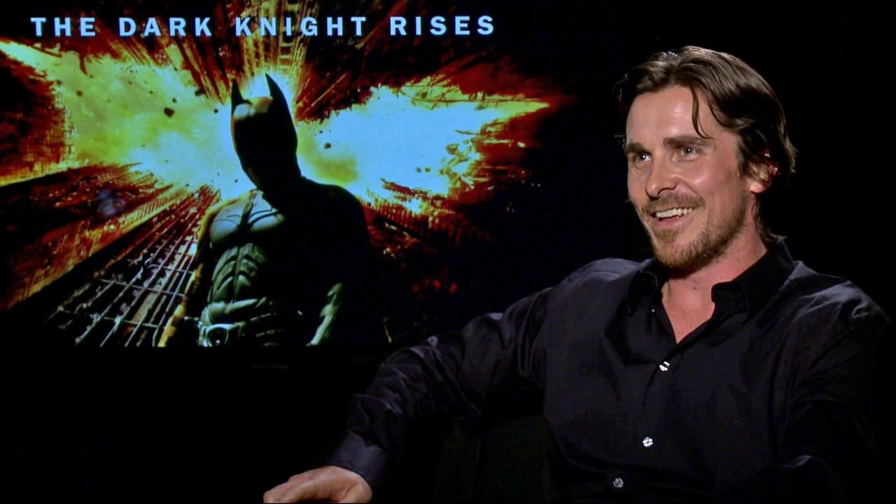 Christian Bale talks to OnTheRedCarpet.com about The Dark Knight Rises in a junket interview on July 9, 2012.