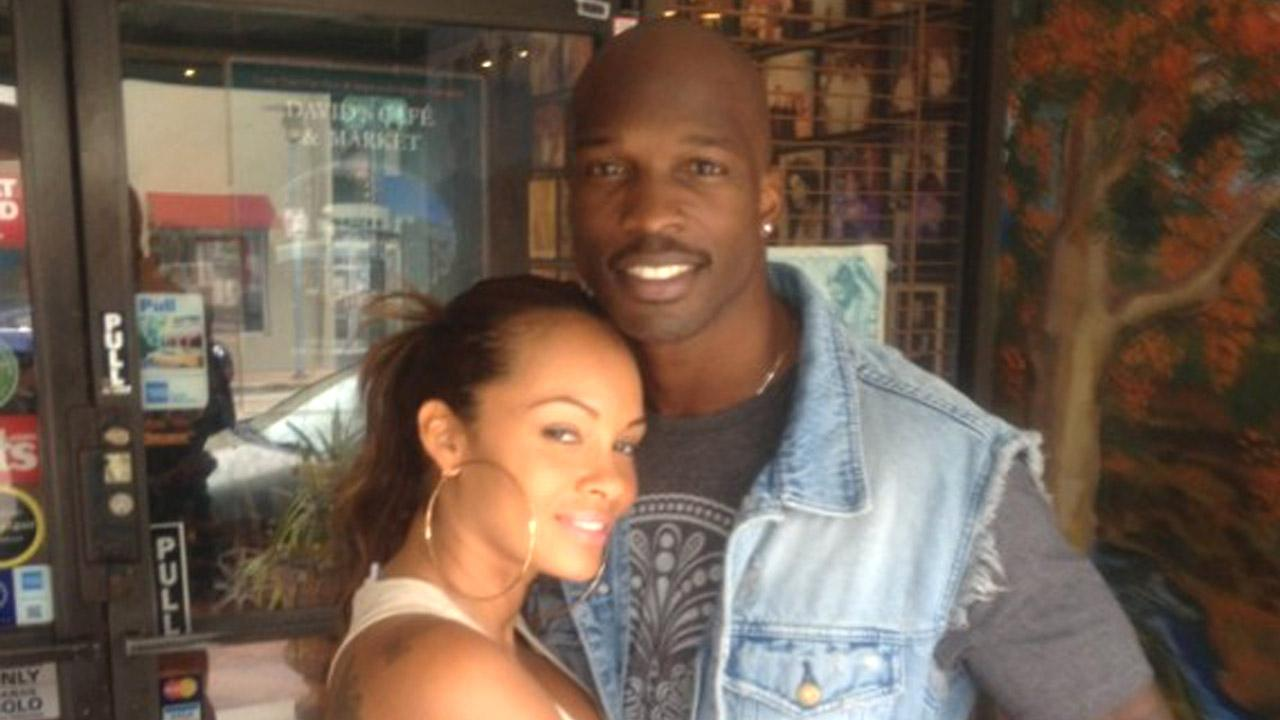 Chad Johnson and his wife, Evelyn Lozada, pose for a picture in this undated file photo posted on his website, ochocinco.com.