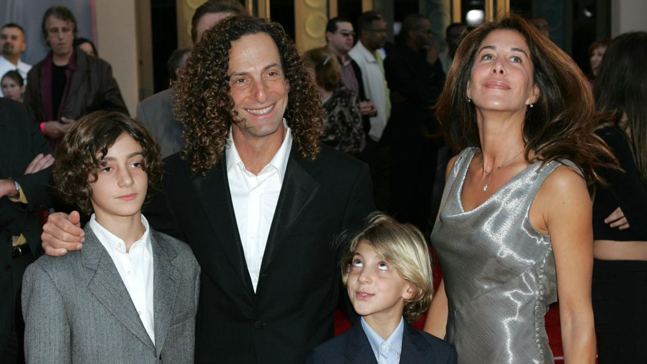 Kenny G, second from left, Lyndie Benson, right, Max, left, and Noah arrive for the 32nd annual American Music Awards, Sunday, Nov. 14, 2004, at the Shrine Auditorium in Los Angeles.Reed Saxon