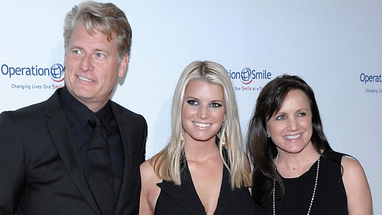 Singer Jessica Simpson, center, her father Joe Simpson, right, and mother Tina Simpson arrive at the Operation Smile Smile Gala in Beverly Hills, Calif. on Friday, Oct. 2, 2009.Dan Steinberg