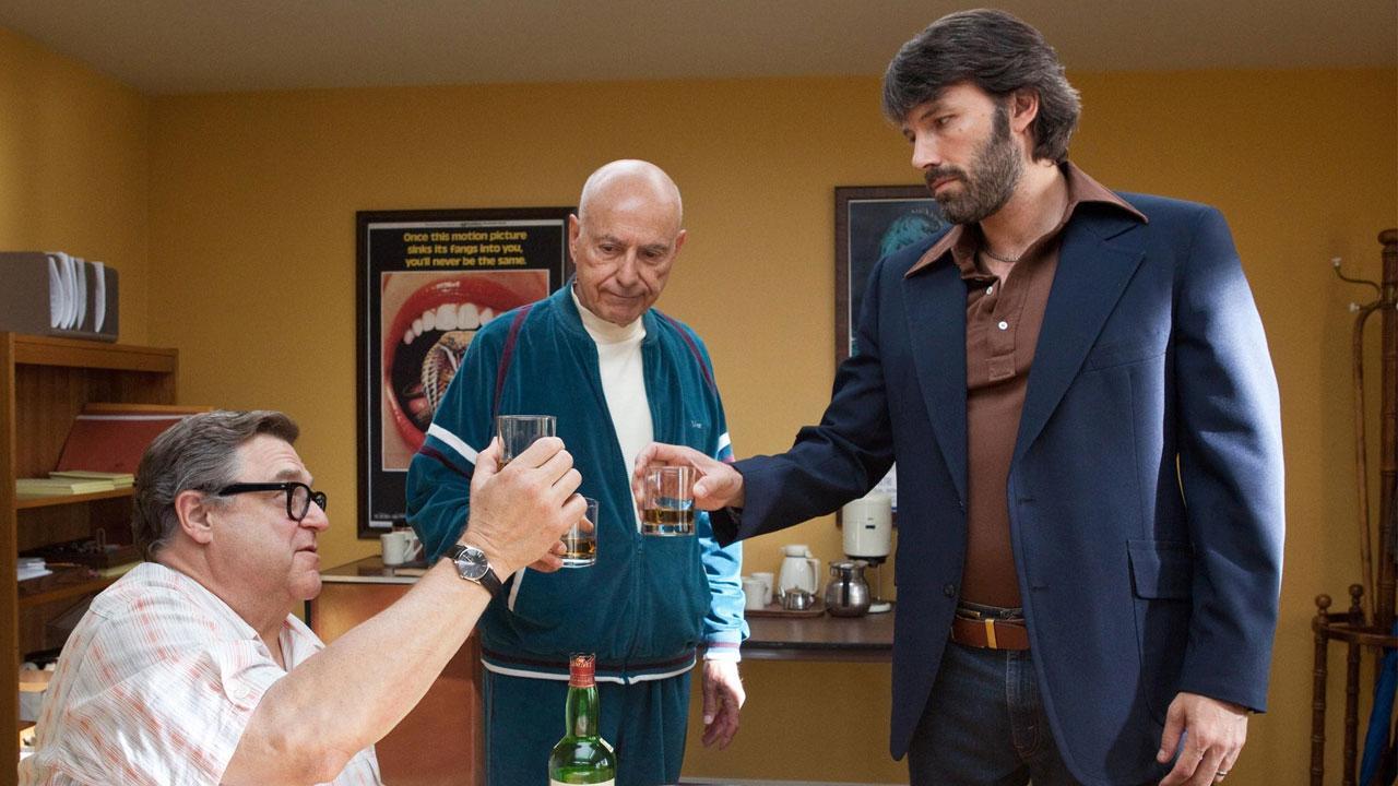 Ben Affleck, Alan Arkin and John Goodman appear in a scene from the 2012 movie Argo.
