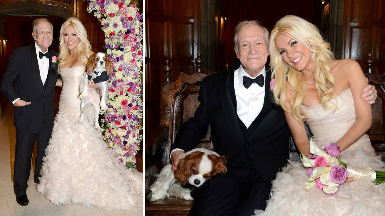 Hugh Hefner and Crystal Harris posed with their Cavalier King Charles Spaniel Charlie for an official wedding photo. The two tied the knot at the Playboy Mansion on Dec. 31, 2012 -- New Years Eve.