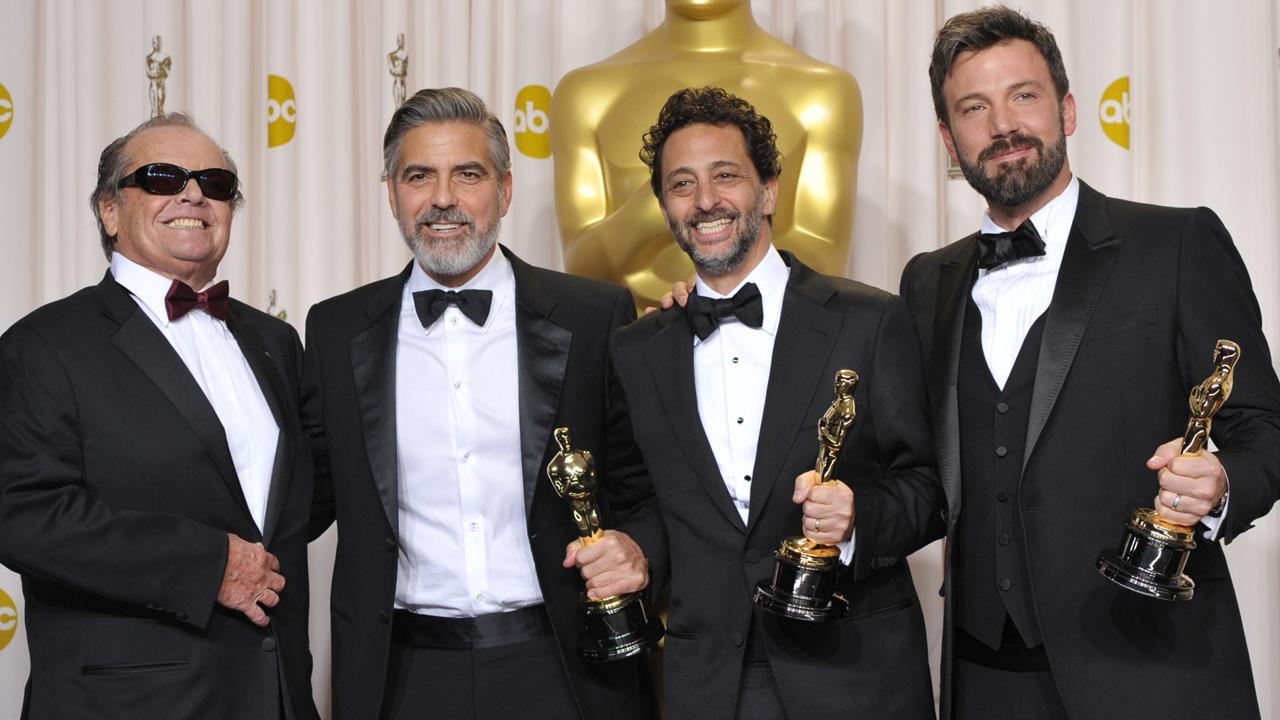From second left, George Clooney, Grant Heslov, and Ben Affleck pose with their awards for Best Picture for Argo with presenter Jack Nicholson during at the Oscars at the Dolby Theatre on Sunday Feb. 24, 2013, in Los Angeles.