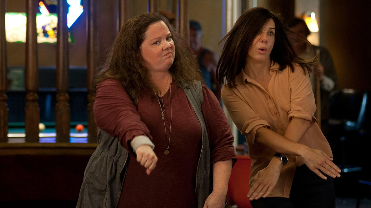 Sandra Bullock and Melissa McCarthy appear in a scene from the 2013 movie The Heat. Bullock plays an FBI agent and McCarthy plays a foul-mouthed Boston cop. They team up to try to nab a ruthless drug lord.