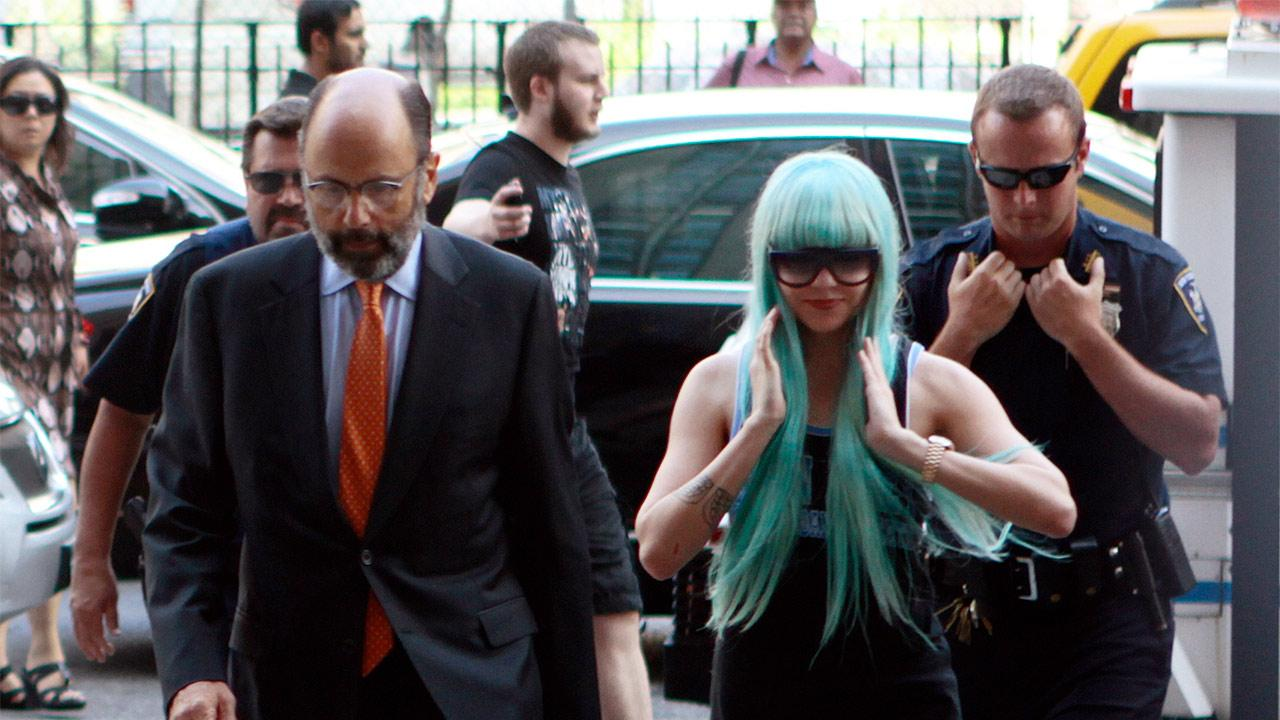 Amanda Bynes appears before a judge on July 9, 2013. She was arrested in Manhattan in May. Police say the actress threw a bong out of a window.