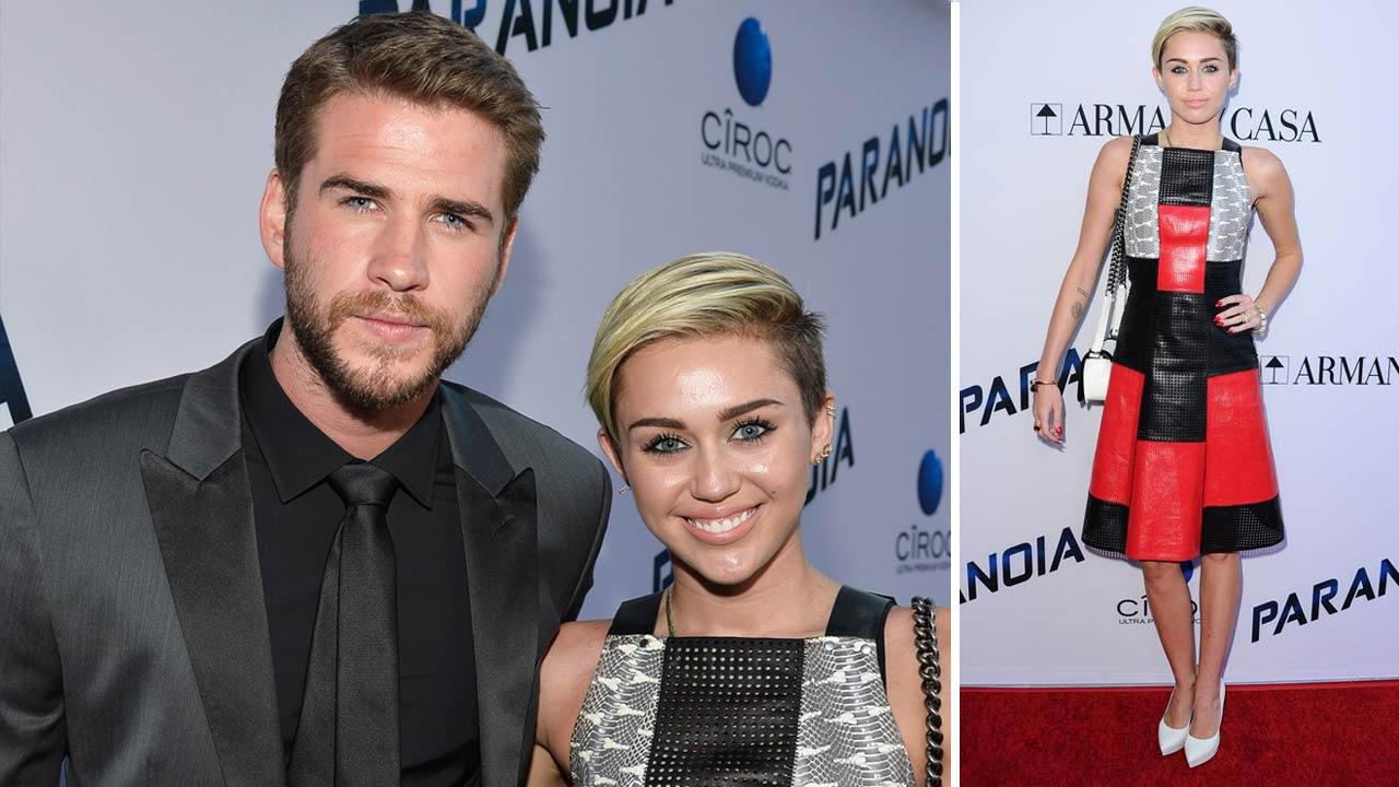 Miley Cyrus and Liam Hemsworth appear at the Los Angeles premiere of Paranoia on Aug. 8, 2013.