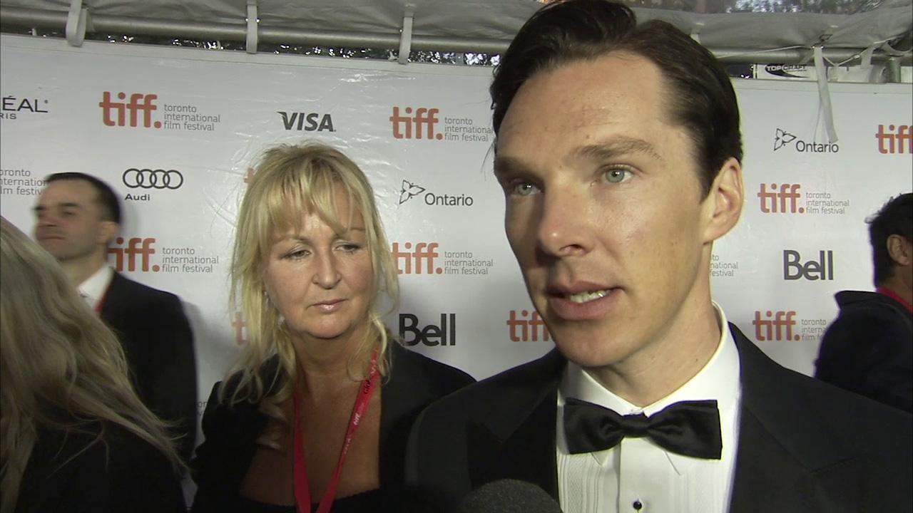 Benedict Cumberbatch poses with fans at the premiere of his new film The Fifth Estate, in which he plays WikiLeaks founder Julian Assange, at the 2013 Toronto International Film Festival in Toronto on Sept. 5, 2013.