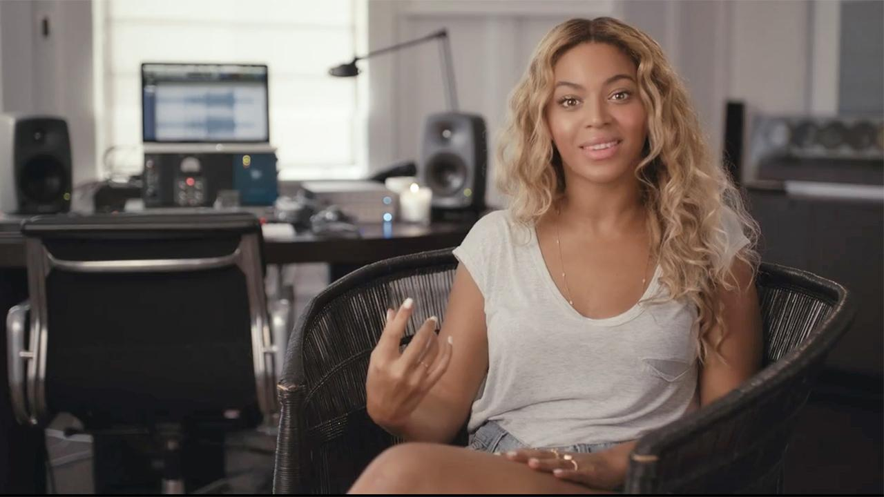 Beyonce appears in a video posted on Dec. 12, 2013 on her Facebook page in which she talks about her new 2013 visual album, Beyonce - a surprise release.