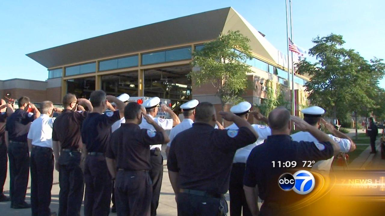 Chicago firefighters at Engine 18 on the Near West Side marked the moment the first plane struck the World Trade Center 11 years ago with a salute and a moment of silence, Tuesday morning, September 11, 2012.