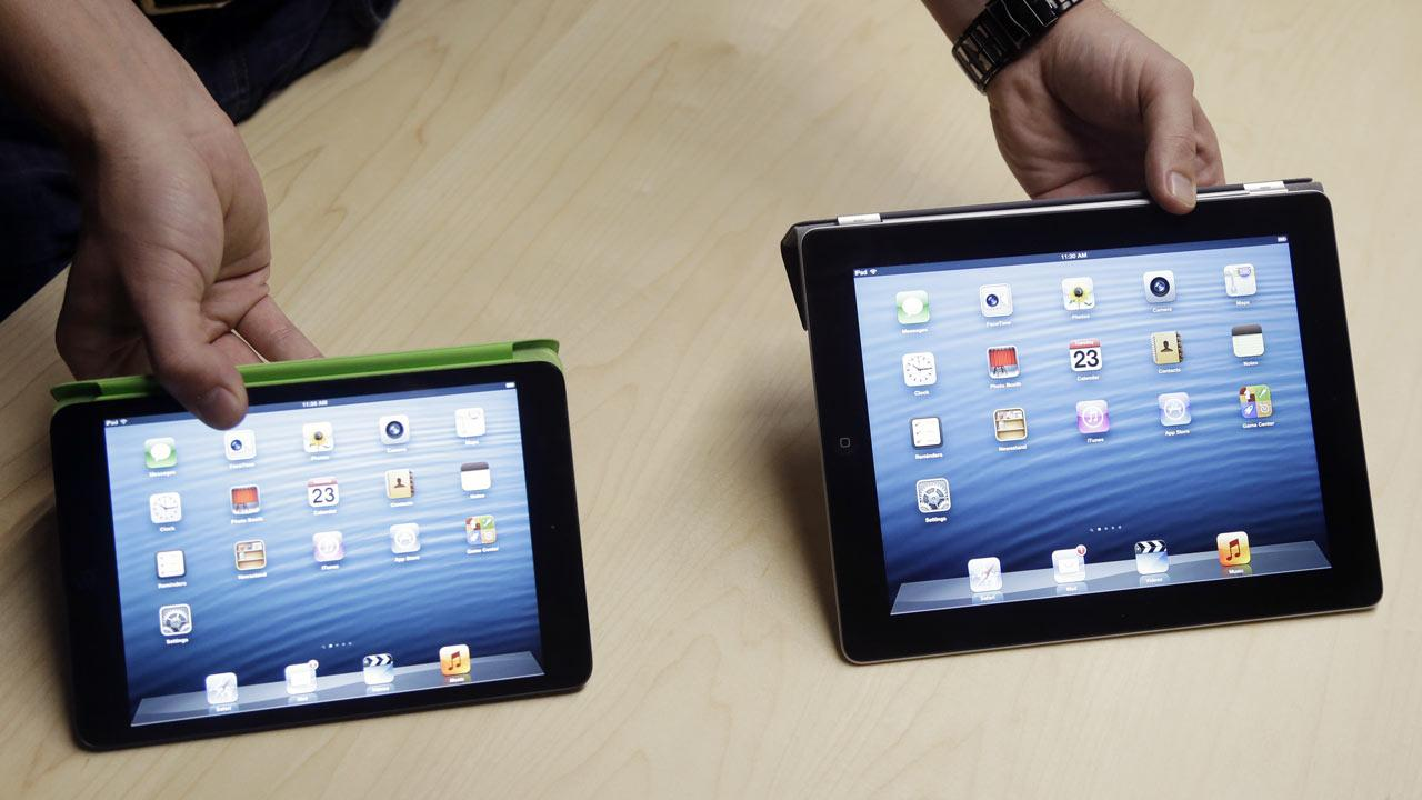 The iPad Mini, at left, is shown next to the 4th Generation iPad in San Jose, Calif.