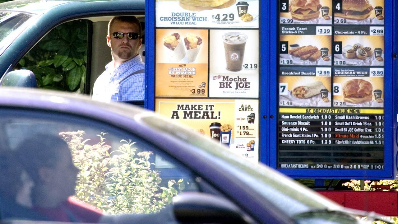 In this file photo, customers view the menu in the drive through line at a Burger King in Portland, Ore.  (AP Photo/Don Ryan, File)