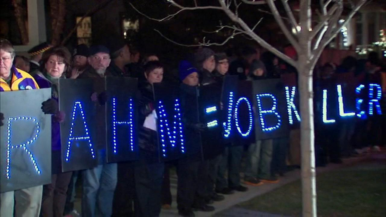 O'Hare janitors protest outside Mayor Emanuel's house