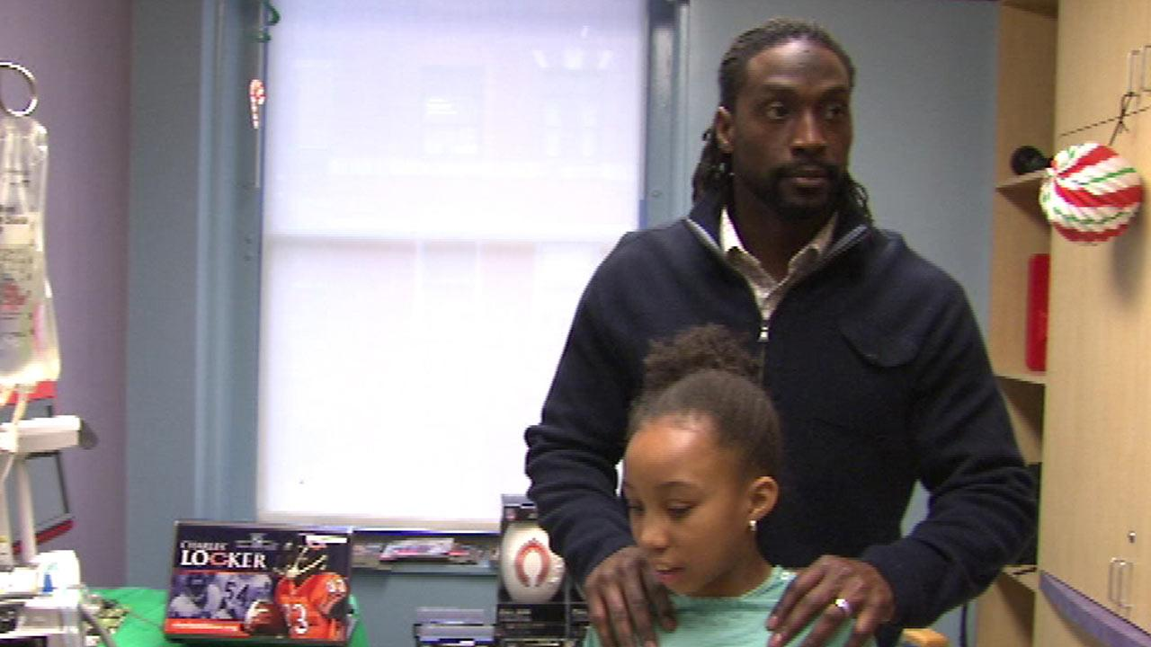 Charles Tillman passes out gifts at Rush Children's Hospital