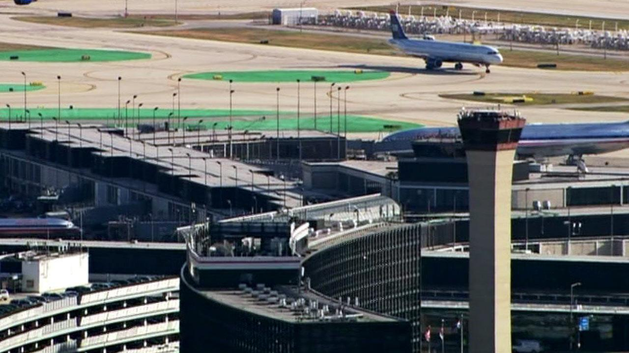 The runway and control tower at OHare International Airport are seen in this file photo.