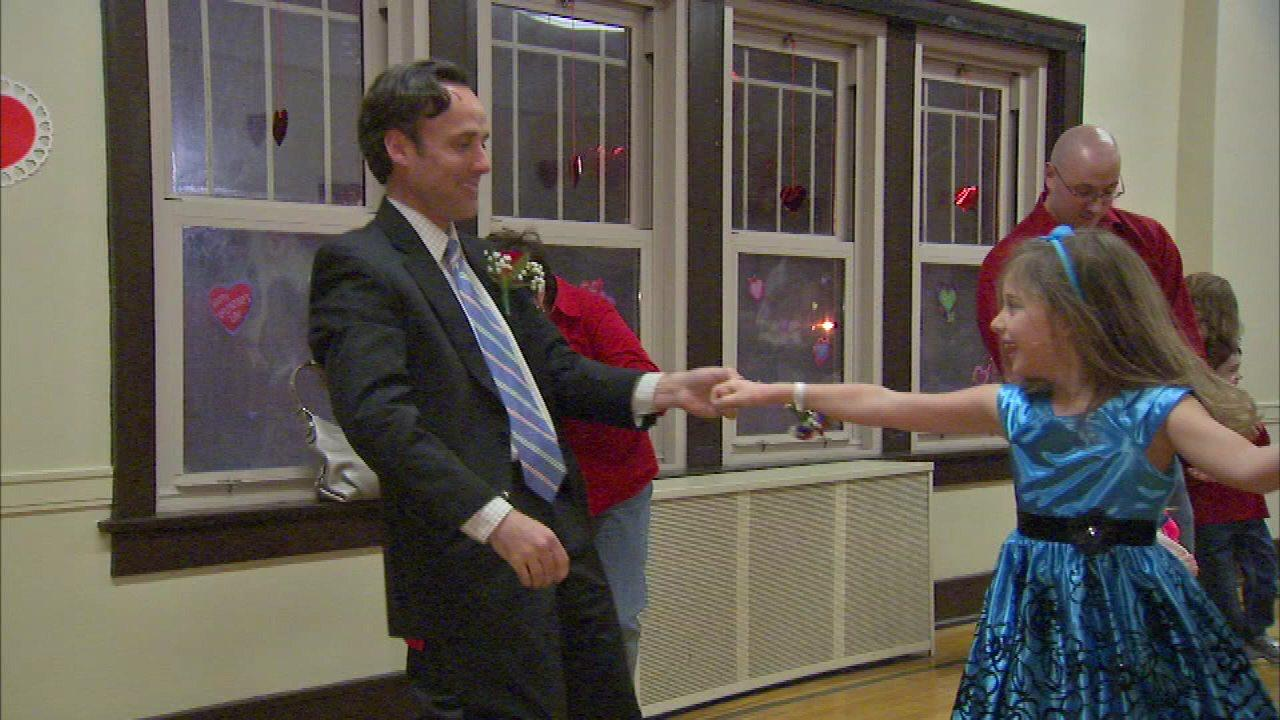 Families celebrate Valentine's Day together at dance