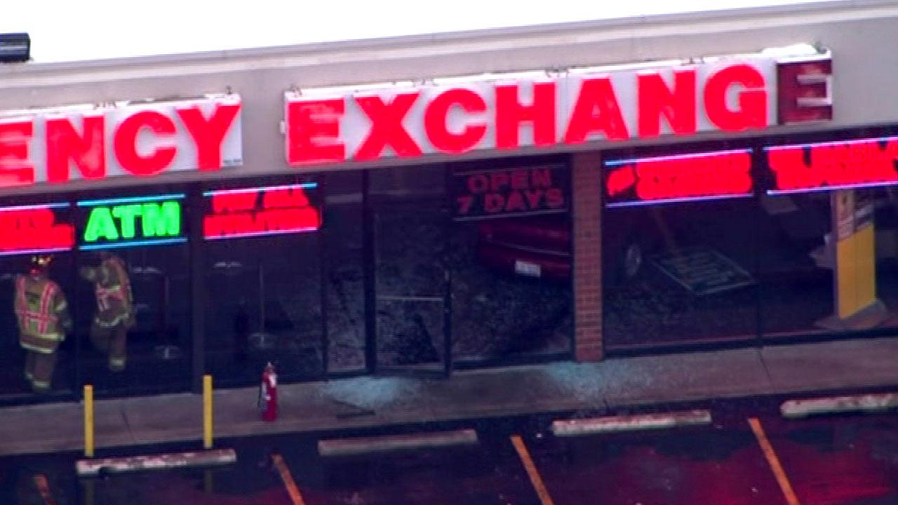 Car crashes into currency exchange in Berwyn