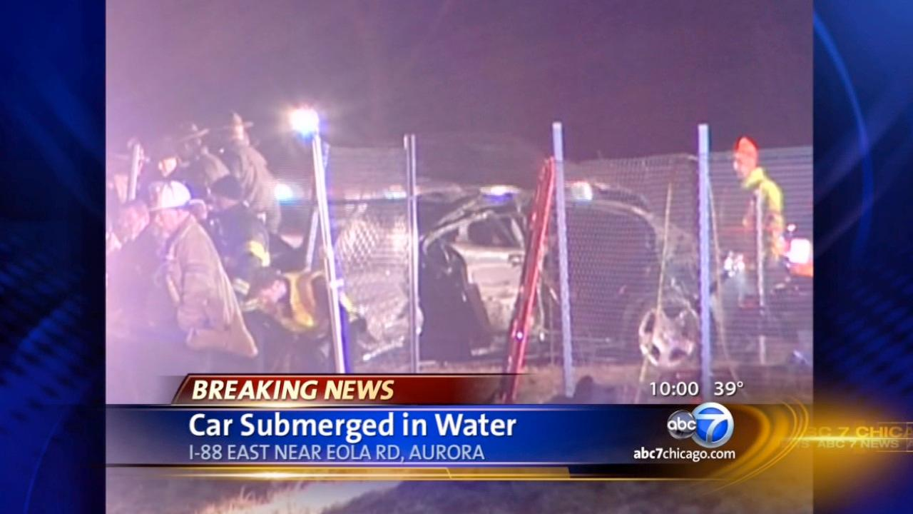 Car veers off road, ends up in retention pond near I-88