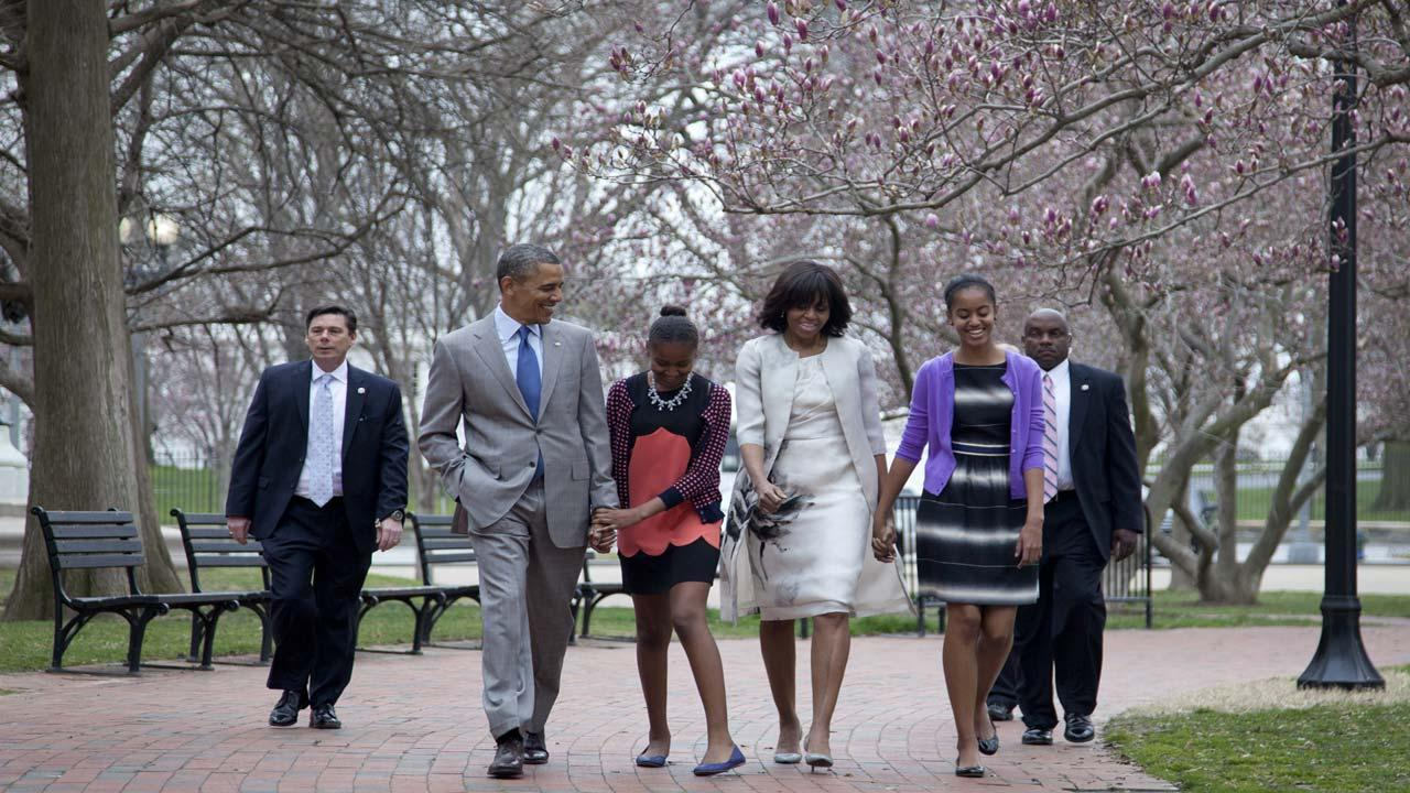 President Barack Obama and first lady Michelle Obama walk from the White House with their daughters Sasha Obama, second from left, and Malia Obama, right.