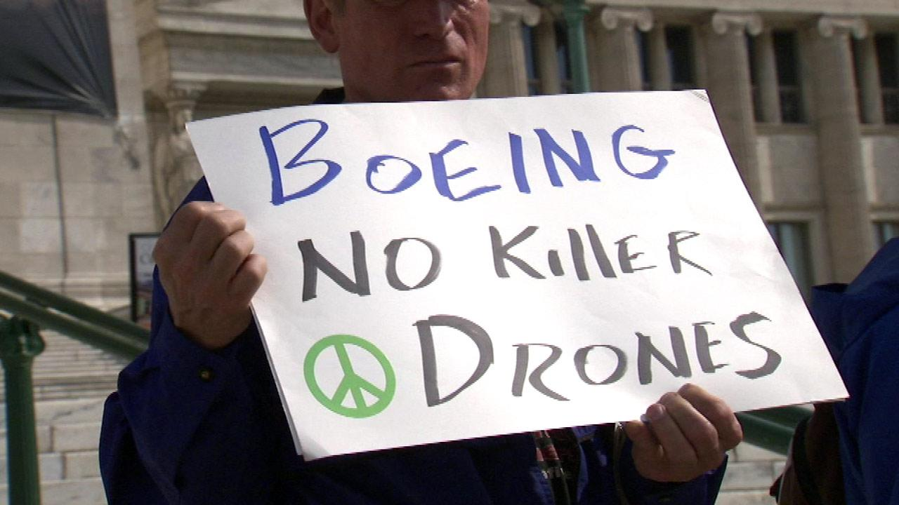 The annual Boeing meeting at the Field Museum in Chicago drew a few protesters Monday, April 29, 2013. They were demonstrating against Boeings production of military drones.