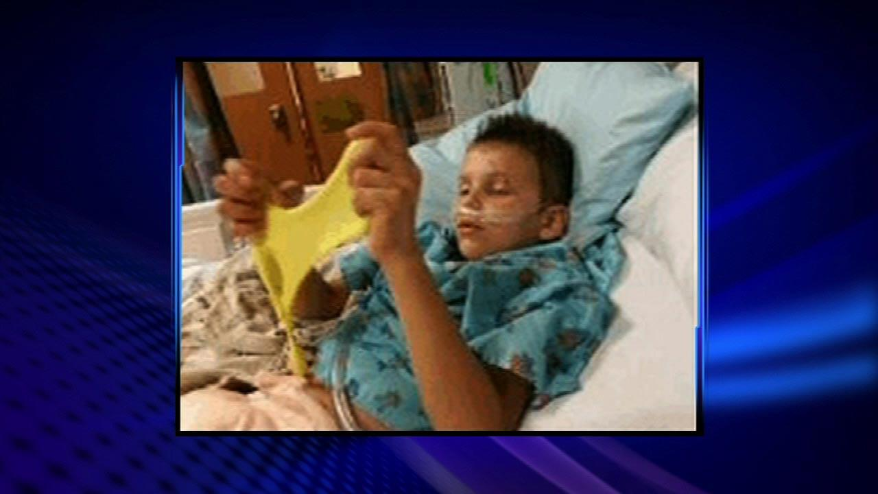 Pictures show recovery of boy buried in dunes