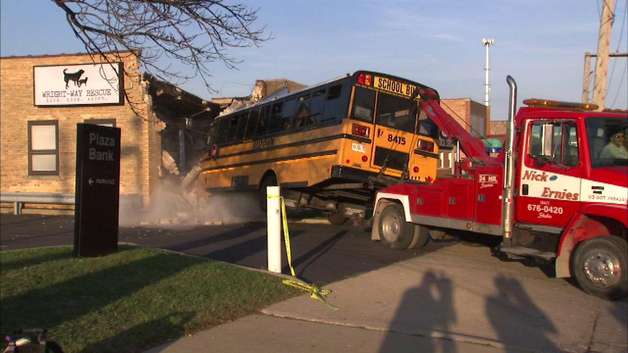 A school bus that crashed into the front of an animal rescue center in the 7100-block of West Touhy in north suburban Niles Wednesday afternoon is removed from the building on Thursday morning.