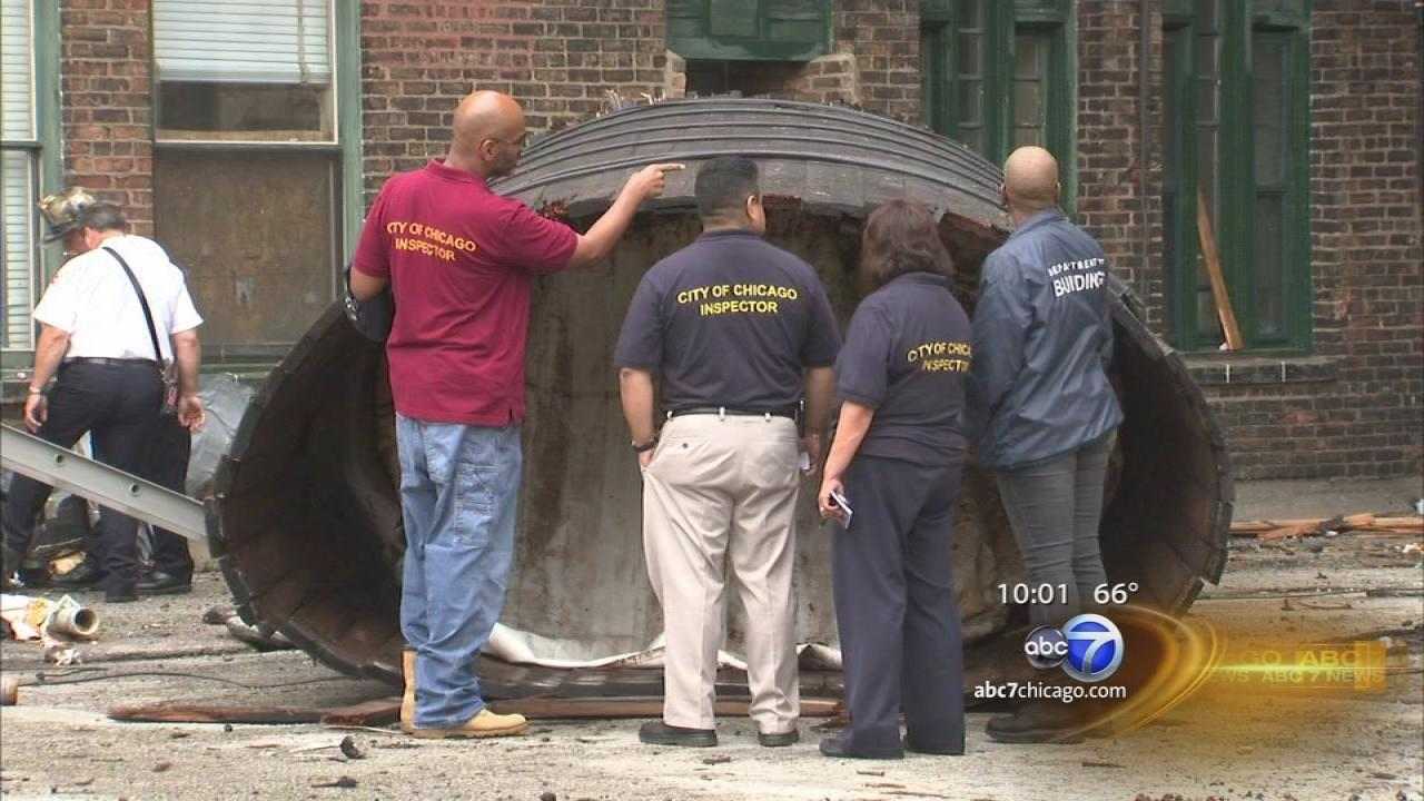 2 remain hospitalized after water tank accident