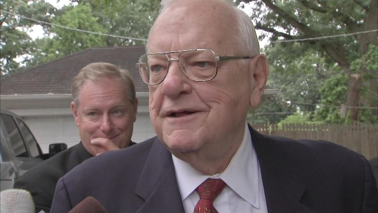 George Ryan speaks with reporters soon after release from home confinement on July 3, 2013.
