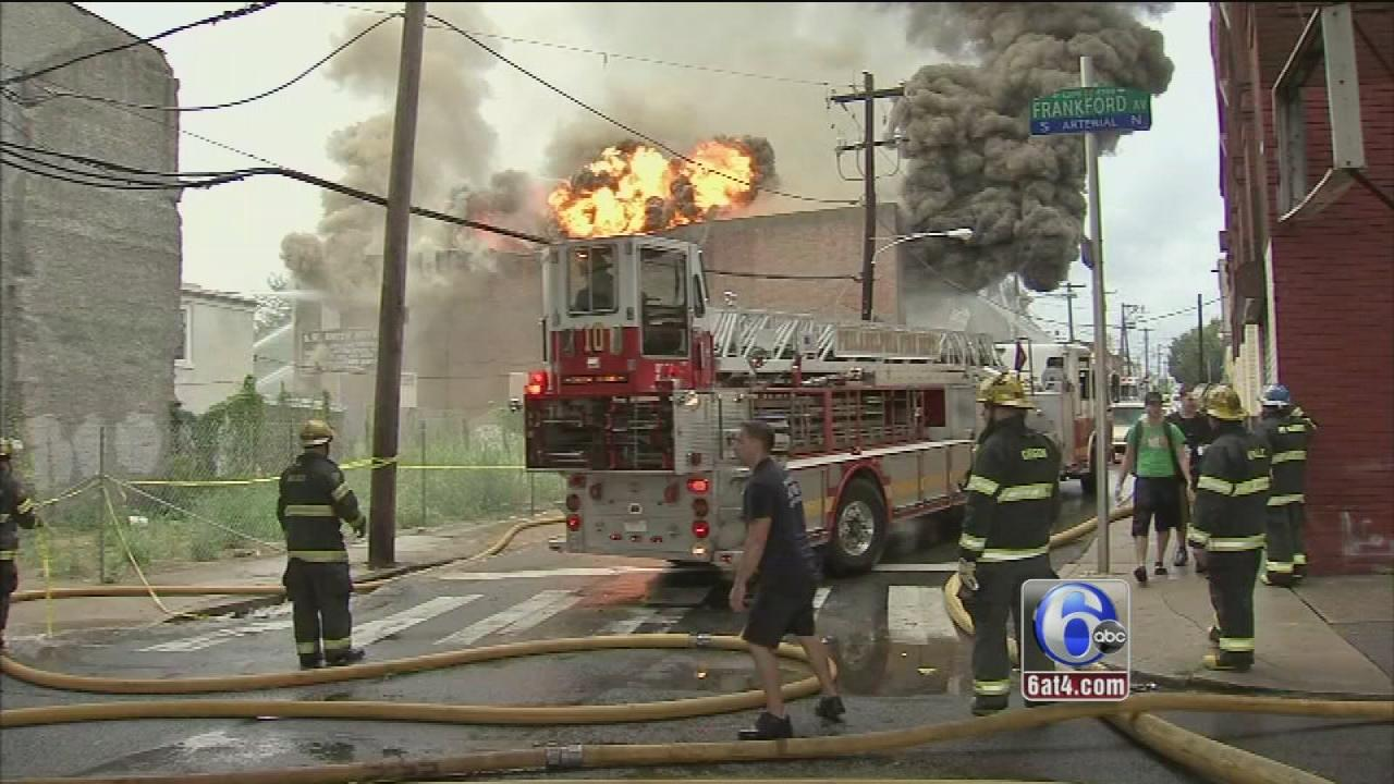 Firefighters battle a 3-alarm blaze at a furniture store and storage facitily in Philadelphias Frankford section on Labor Day.