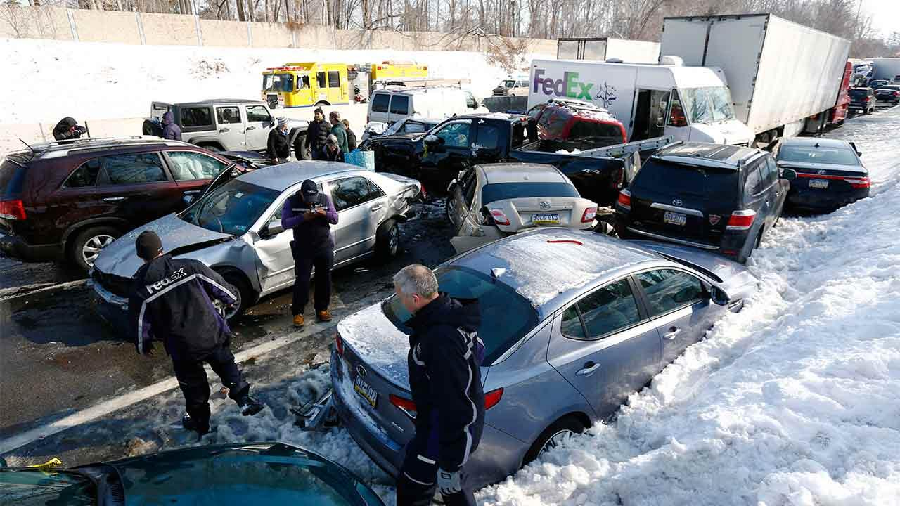 Vehicles are piled up in an accident, Friday, Feb. 14, 2014, in Bensalem, Pa. Traffic accidents involving multiple tractor trailers and dozens of cars have completely blocked one side of the Pennsylvania Turnpike outside Philadelphia and caused some injuries.