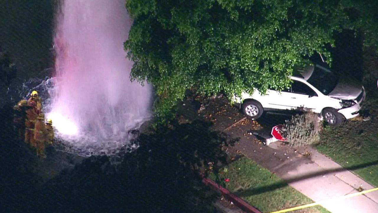The driver of a white SUV plowed into a fire hydrant and power pole in Valley Village on Wednesday, Aug. 22, 2012. Two Good Samaritans were killed trying to help the driver and five others were injured as well.