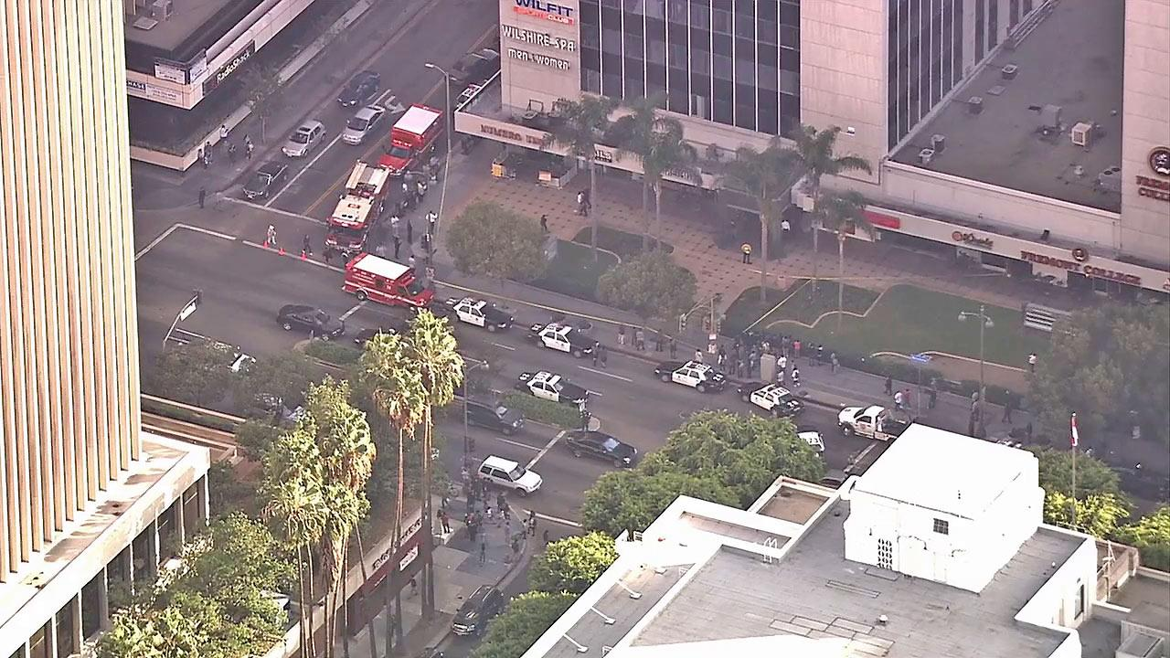 Police and first responders are seen at an office building at Wilshire Boulevard and Mariposa Avenue in Koreatown after one person was shot at an office building on Thursday, Nov. 1, 2012.