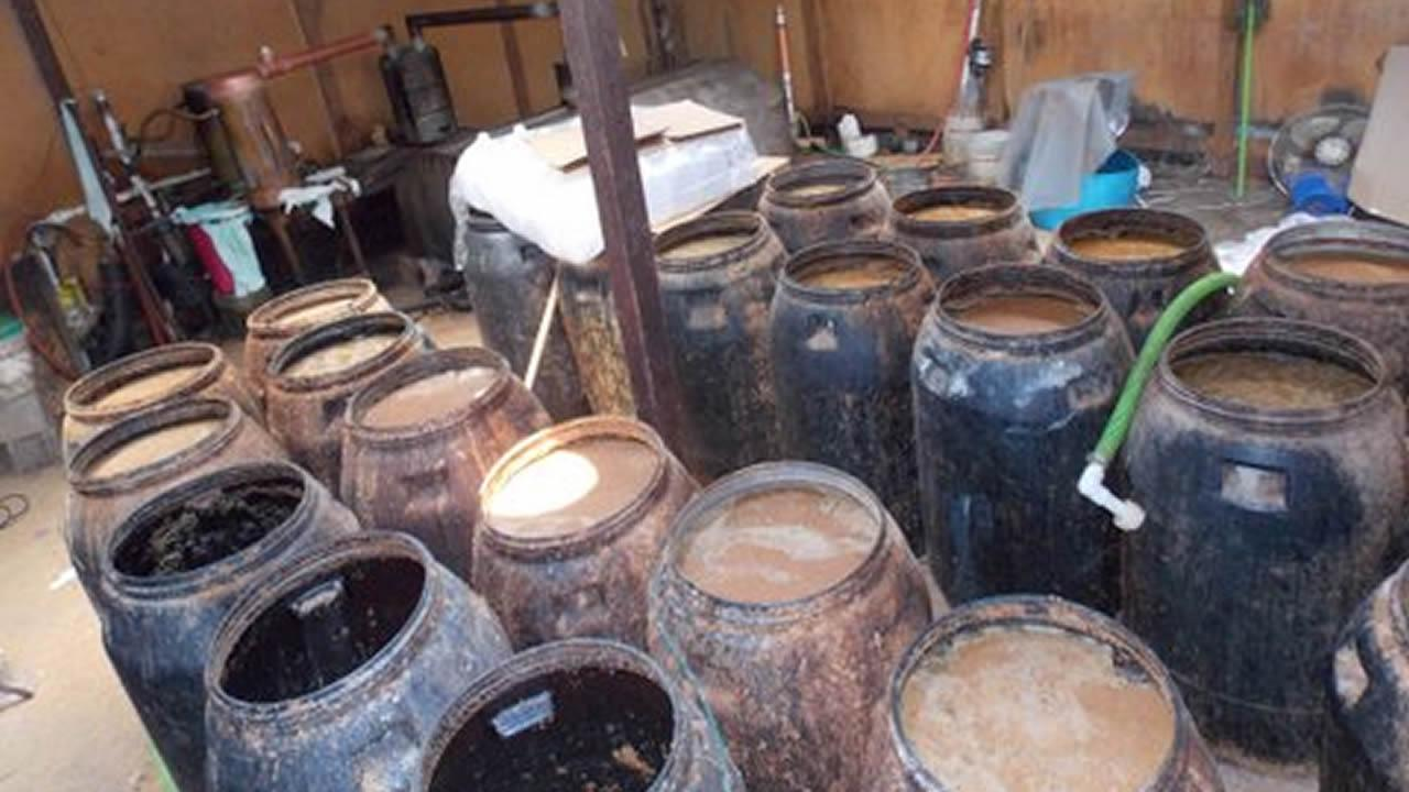 Officers say they found a large moonshine operation in a barn north of Benson. (Image courtesy Mickey Lamm/WTSB Radio)