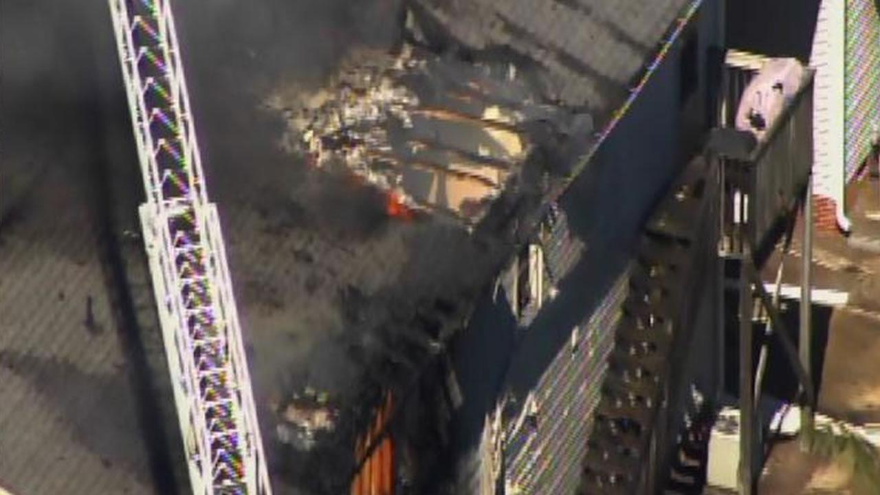 Flames heavily damaged an apartment building in downtown Clayton Monday afternoon.