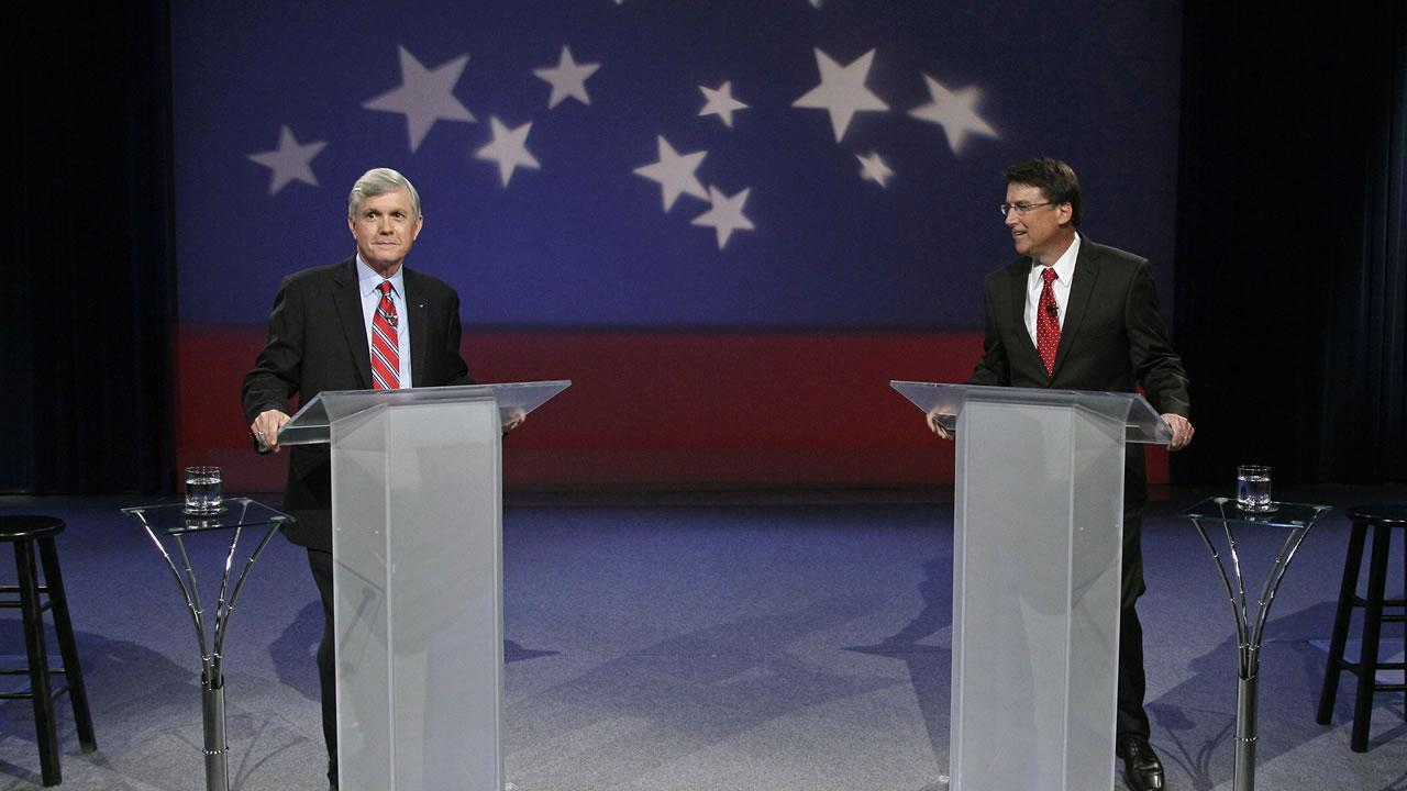 Democrat Walter Dalton, left, and Republican Pat McCrory prepare for a televised gubernatorial debate at the University of North Carolina Television network in Research Triangle Park, N.C., Wednesday, Oct. 3, 2012. (AP Photo/Gerry Broome)