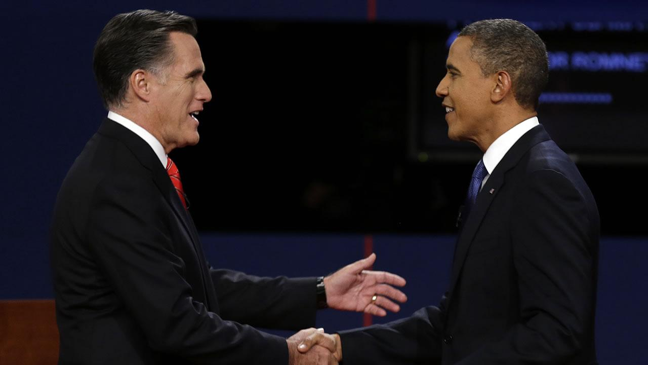 Republican presidential nominee Mitt Romney and President Barack Obama shake hands before the first presidential debate at the University of Denver, Wednesday, Oct. 3, 2012, in Denver.