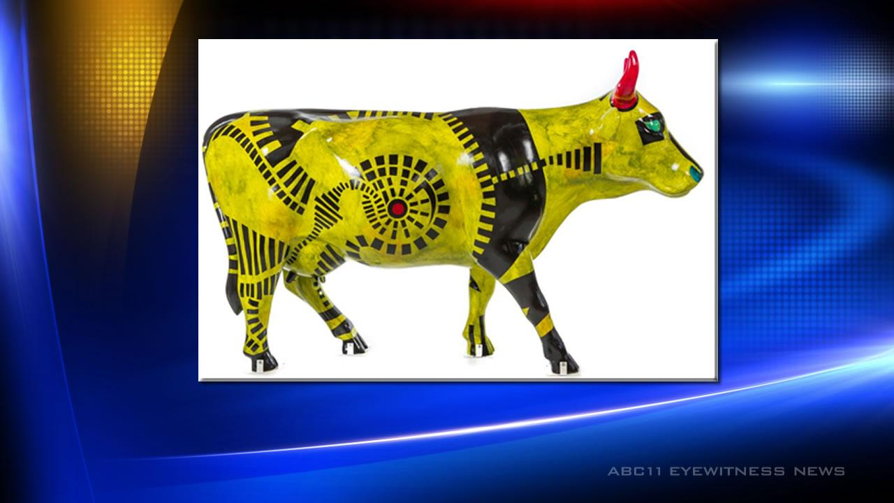 The sculpture - called The Cow is Greener on the Other Side - is one of more than 80 created for CowParade North Carolina 2012.