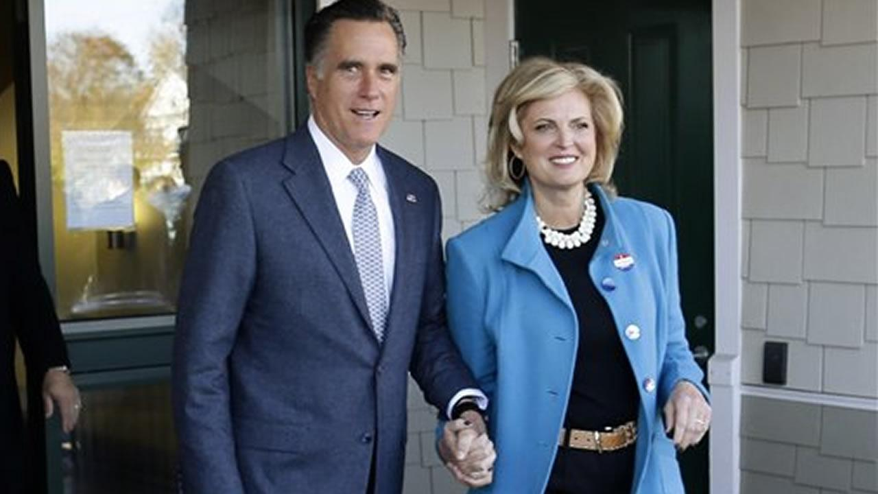 Republican presidential candidate, former Massachusetts Gov. Mitt Romney and his wife Ann Romney emerge after they voted in Belmont, Mass., Tuesday, Nov. 6, 2012. (AP Photo/Charles Dharapak)