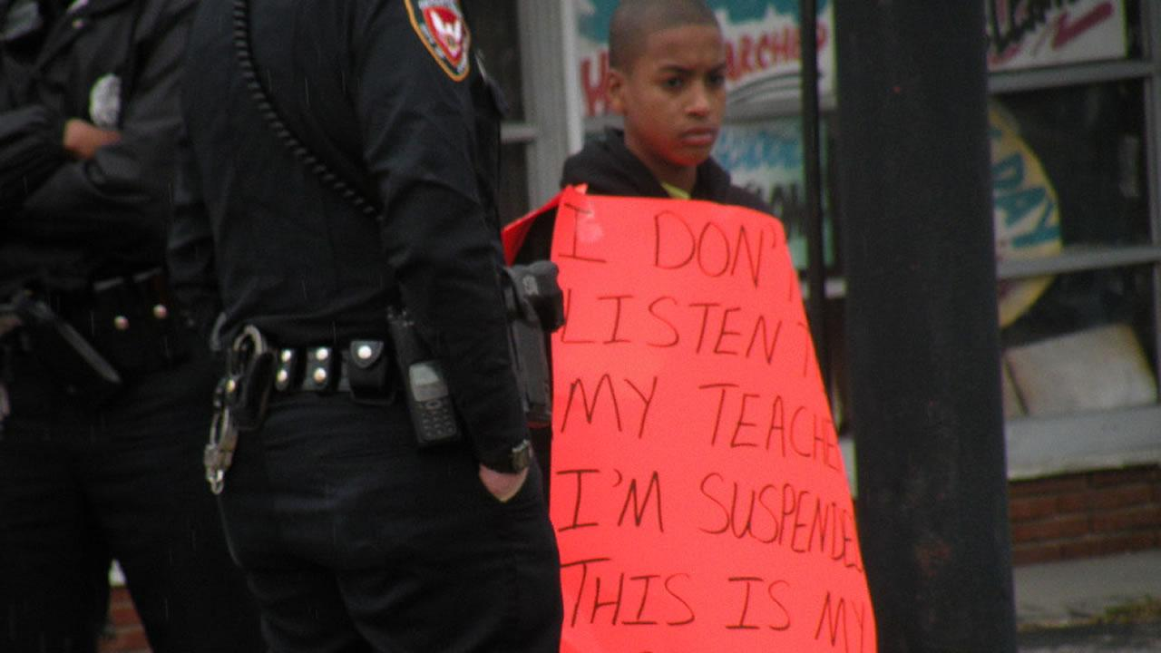 Parrish Pierce was forced to wear a sign by his mother after he was suspended from school.