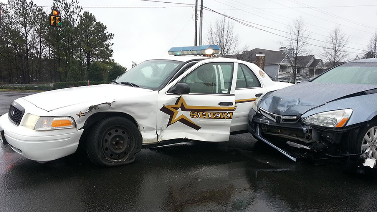 The sheriffs cruiser collided with another car at Page Road and T.W. Alexander Drive.
