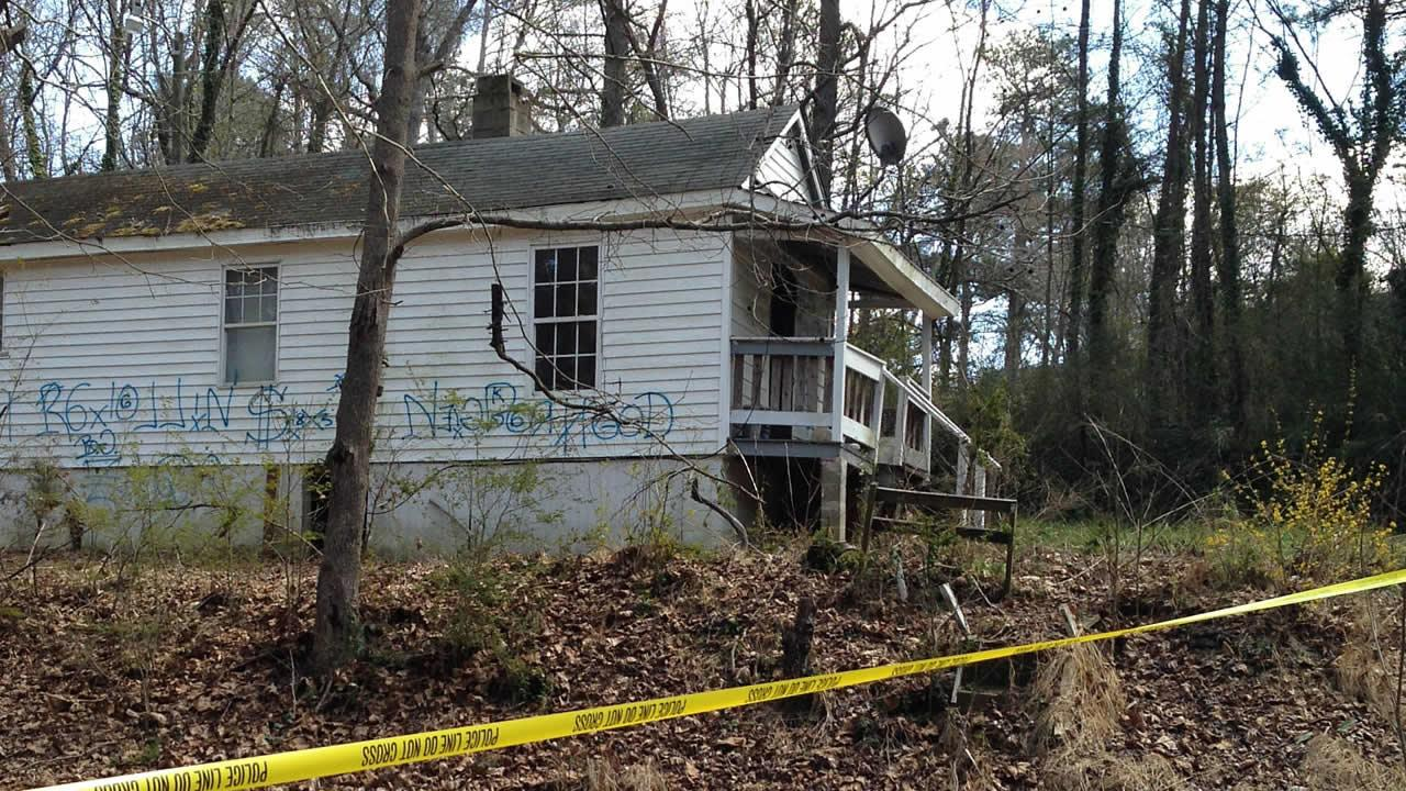 Authorities say a woman was attacked near this vacant home.