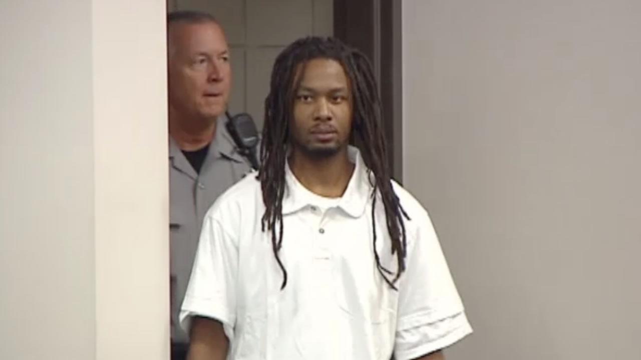 Mario McNeill enters the courtroom.